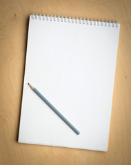 notebook with pencile on a wooden