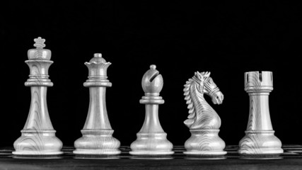 Chess pieces in line
