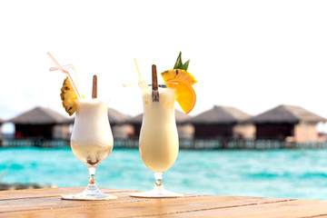 Two cocktails on tropical beach vacation