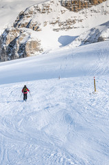 Skier on a ski trail in the mountains