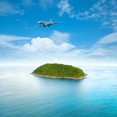 Fototapete - Private jet plane over the tropical island