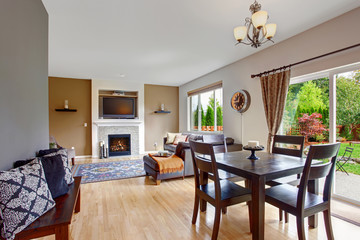 American house interior with open floor plan. DIning room with e
