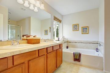 Bathroom with honey tone vanity cabinet