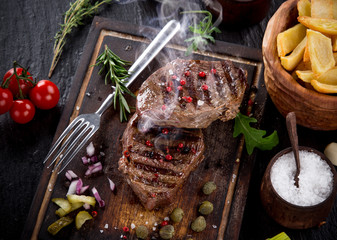 Delicious beef steak on stone table, close-up