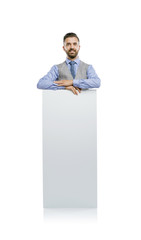 Hipster businessman with blank advertisement