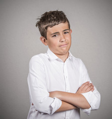 skeptical young man looking at you isolated on grey background