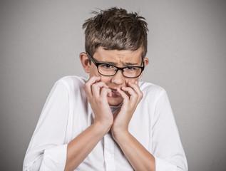 Headshot anxious stressed boy isolated on grey background