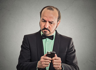 puzzled confused businessman looking at smartphone