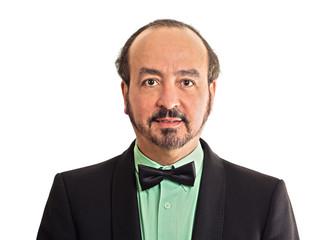 portrait mature gentleman wearing bow tie on white background