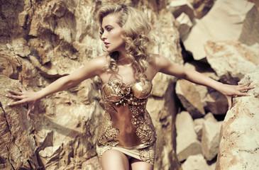 Poster Artist KB Blond pretty woman among the rocks