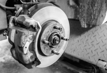 Repairing brakes on car  by monochromatic