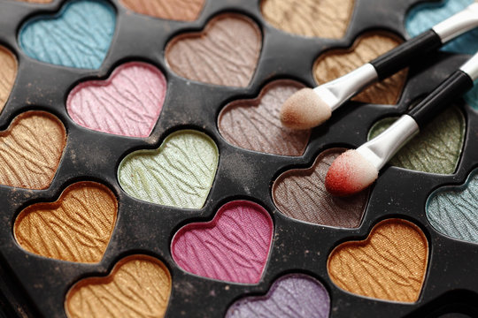 Eyeshadow heart shaped palette with applicators.
