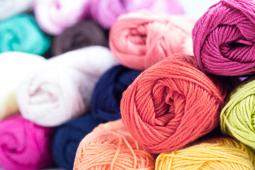 colors of yarn thread on white background