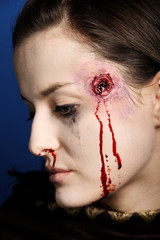 Portrait of a woman shot in the head.