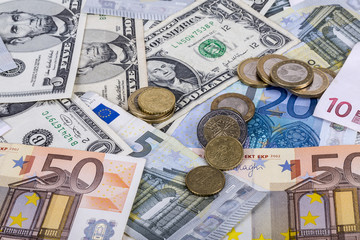 banknotes and euro coins and dollar