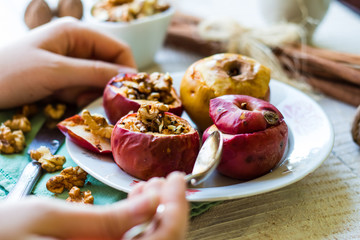 eating baked apples with walnuts, honey , dessert, christmas