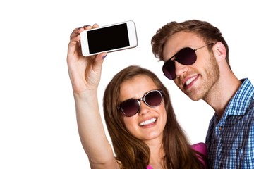 Couple taking selfie with smart phone