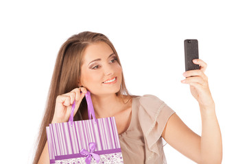Beautiful girl with shopping bags  taking selfie