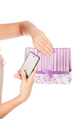 girl holding shopping bags and taking selfie with cell phone