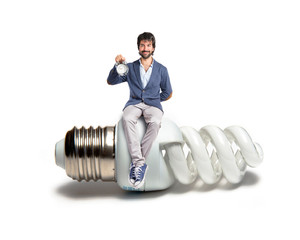 Man holding a clock sitting on bulb