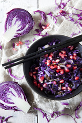 sauteed purple cabbage and pomegranate grains on bowl