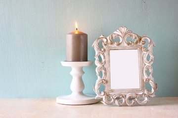 low key image of vintage antique classical frame and Burning can