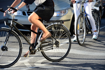 Woman on bicycle in traffic