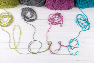 Love word formed with colorful knitting yarn
