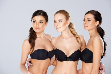 Three sexy woman posing in black lingerie
