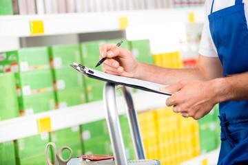 Supermarket clerk at work