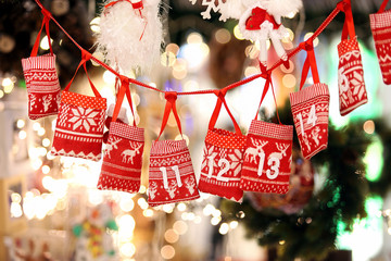 Fototapeta Small bags as Advent calendar with Sweets surprises hanging on a obraz