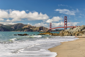 Beach, rocks and bridge Golgen Gate, San Francisco