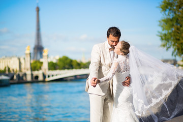 Bride and groom on the Seine embankment in Paris