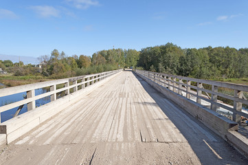 Old wooden bridge in the rural countryside