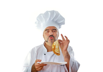 Playful Chef eats a pancake