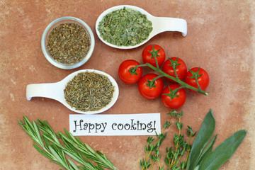 Happy cooking card with cherry tomatoes, fresh and dried herbs