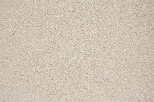 Beige plaster wall texture background