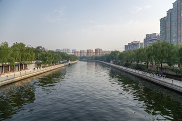 China, Beijing. City landscape with the river and quay