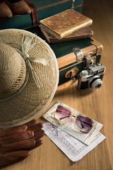 Traveler with vintage camera and maps