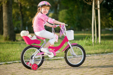young girl on bike, active child concept