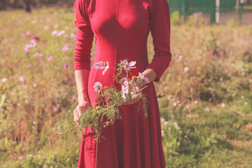 Young woman standing in a meadow