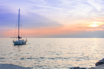 Small vessel in sunset