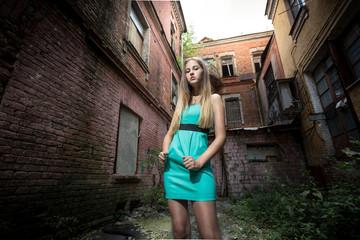 elegant woman against ruined building