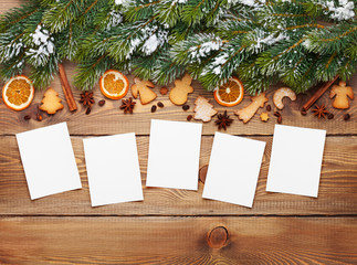 Christmas background with photo frames, snow fir tree, spices an