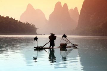 Fototapeta Chinese man fishing with cormorants birds obraz