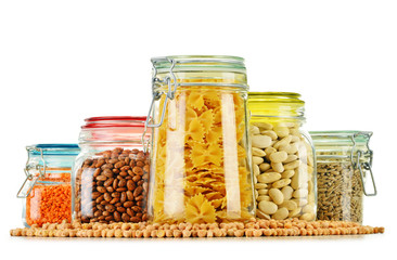 Jars with grain foods isolated on white