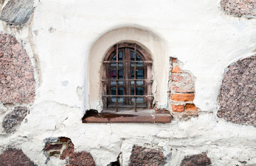 Background texture of old white stone wall with window