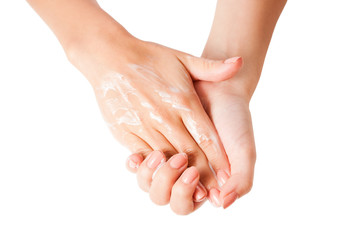 Female hands using body lotion, isolated on white background.