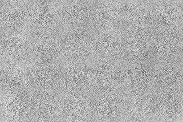 Gray wall with decorative stucco. Photo background texture