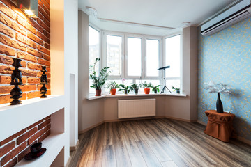 Spacious apartment - Brick wall in modern living room